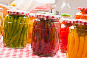 jars of colorful pickled beets, green beans, and carrots