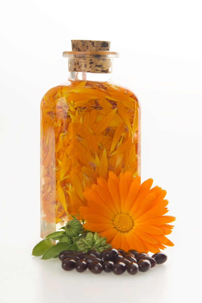 Orange flowers in a bottle.