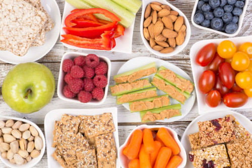 62914016 - healthy snacks on wooden table, top view